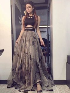 If you're a bridesmaid, Indian wedding lehengas now have a new look - crop tops as lehenga blouses! A style that meets midway between western fashion and Indian tradition. Indian Bridal Outfits, Indian Designer Outfits, Designer Dresses, Lehnga Dress, Lehenga Blouse, Blouse Dress, Party Wear Lehenga, Party Wear Dresses, Stylish Dresses