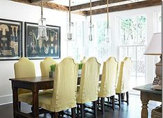 While slipcovered dining chairs are fairly common, we think they can be pretty tough to pull off. Except, perhaps, in an actual farmhouse, slipcovers can look very faux-farmhouse. Lately, though, we've come across some gorgeous examples of the slipcovered look, so we came up with a few suggestions for how to make it work...