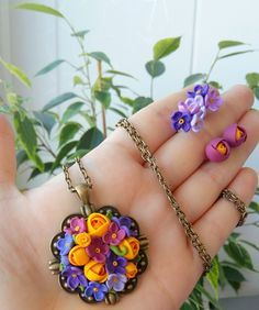 Floral pendant from polymer clay with bronze elements