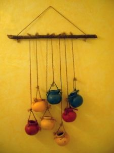 coloured small pots adding a knot and fix on wall with wooden log.Creation which afford your pocket and art which easy to create at home. Ethnic Home Decor, Indian Home Decor, House Plants Decor, Plant Decor, Garden Plants, Diy Home Crafts, Diy Arts And Crafts, Diy Wall Decor, Diy Home Decor