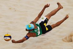 Emanuel Rego of Brazil in action during the 2012 Swatch FIVB World Tour Beijing Grand Slam pool N match with Alison Cerutti against Sascha Heyer and Sebastian Chevallier of Switzerland in Chaoyang Park on May 10, 2012 in Beijing, China.