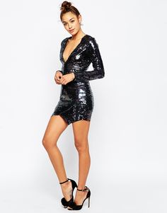 Go all-out 80s with this sequin wrap dress