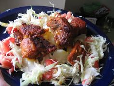 Nicarguan Fried Pork over Vigoron (Cabbage, Tomatoes, Onions, Jalepenos marinated in Vinegar and Lime Juice) and Yuca