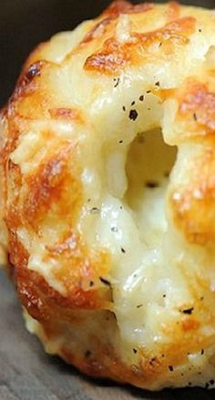 Cheesy garlic bites... Made with can biscuits, mozzarella balls, butter, & more cheese.