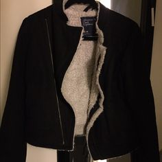 Black jacket American eagle black jacket with tan fuzzy inside and front zipper. In very good condition! American Eagle Outfitters Jackets & Coats Utility Jackets