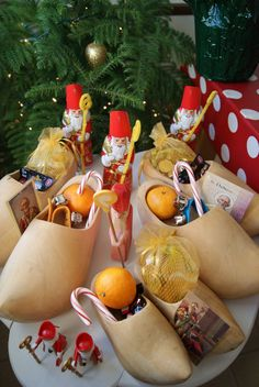 classic st Nicholas loot -- oranges, candy canes, chocolate santas, gold coins.