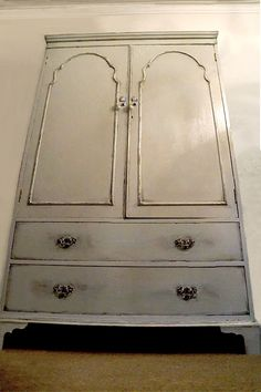 Revamped antique wardrobe Sourced for free, painted in duck egg blue, distressed and varnished   By Ashleigh Barnes