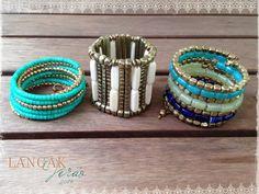 Pulseiras da Tailândia para o nosso Verão! Combinação de dourado e tons de turquesa.  Na loja online.