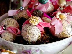 Love th euse of vintage style paper, bits and pieces of ribbon, old buttons and millinery flowers.