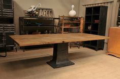 Industrial dining table cast iron base 1900 Oak top From FarFetchers.com