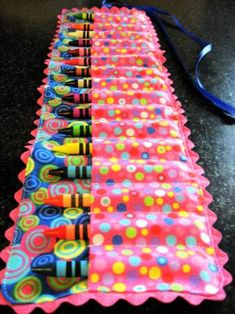 "I see these crayon ""cozies"" holders everywhere and they are easy to make. If you don't want to have to figure out the measurements, here is a tutorial on how I made mine."