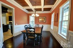 Burnt orange dining room with cream wainscoting | 10192 Fin Point Ct, Leland, NC 28451 | Brunswick County #realestate #northcarolina #brunswickcountync