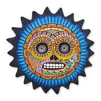 Ceramic wall sculpture, 'Sun of Death'  Saul Montesinos orchestrates a powerful fusion with a Day of the Dead skull presented as a sun, the Aztec symbol of life. Montesinos paints the ceramic sculpture by hand with expert detail. (Novica)