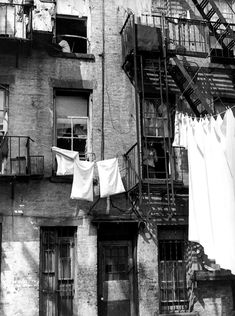 Back of 340 East Street, New York, ca. 1938 ~ Sheldon Dick, Photographer Make a clothes line curtain and fire escape ladder shelves Vintage Photography, White Photography, Street Photography, New York City, Photos Originales, Little Shop Of Horrors, Fire Escape, Vintage New York, Gotham City