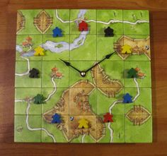 Last I checked this Carcassonne clock is no longer available at their Etsy shop - but if you love board game accents and accessories you'll want to check out their shop! Very creative stuff!