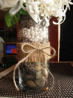 Centerpiece for my table. but with navy blue or yellow printed fabric going around tied with twine instead of the burlap. No flowers but floating candles Pearl Centerpiece, Floating Candle Centerpieces, Rustic Wedding Centerpieces, Diy Centerpieces, Wedding Decorations, Yellow Print, Our Wedding, Wedding Burlap, Wedding Ideas
