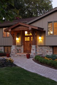 Easy facade fix-up for 1970's style split-level and ranch style homes in Colorado. Perfect, and inexpensive way to change the once ugly drab facades to outstanding drive up curb appeal. The stacked stone and pergola go a long way. #exterior #elevation #rancher #bilevel #trilevel