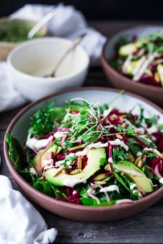 VEGAN POWER SALAD- This Beet and Avocado Salad with Cashew Tahini Dressing, power greens, cashew basil pesto, quick pickled shallots and toasted pumpkin seeds is the BEST! | www.feasingathome...