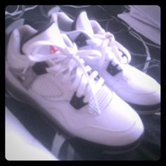 Retro 4s Grade School Grey black white retro Jordan's 4s released in February great condition worn a couple times has original box but it torn some Jordan Shoes Athletic Shoes