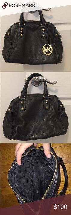Black leather Michael Kors bag Black leather Michael Kors bag with gold hardware, including a gold dangling MK medallion.  Inside features three pockets, two small and one large. This bag can be held by hand or can fit up to your forearm.  This bag has been used and there are some signs of wear and tear, most noticeably in the hanging medallion leather. Please let me know if you'd like more photos! Michael Kors Bags Totes