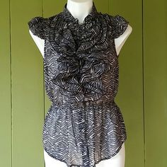 Cute Stripped Summer Top Stretches at the waist and buttons in the front. 100 percent polyester.  Light In weight. elastic in the waist. Ruffles in the front. miley Cyrus Tops