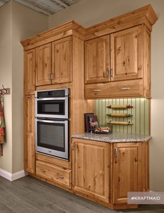 A baking station creates space in the kitchen for cookie- and cake-making, and keeps it from intruding on the rest of the kitchen activity. (KraftMaid cabinets in Natural Rustic Alder)