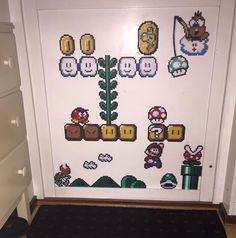 Super Mario perler project on our living room door! Hama perler beads.