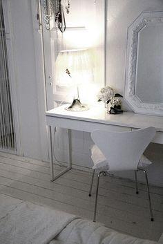 Ikea White Besta burs desk in high gloss white finish.