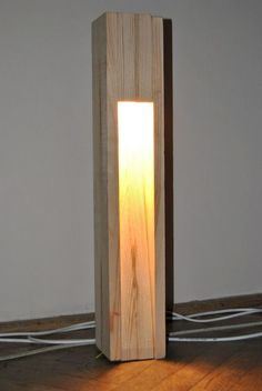 This simple wooden floor lamp has its own way of creating indirect lighting Outdoor Light Fixtures, Outdoor Lighting, Outdoor Lamps, Backyard Lighting, Luminaire Original, Garden Lamps, Wood Lamps, Lighting Design, Lighting Ideas
