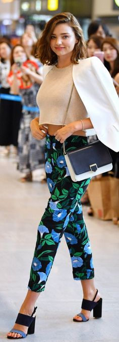 Miranda Kerr arrives at Narita International Airport in Japan wearing Salvatore Ferragamo sandals, and Ann Taylor floral trousers to promote Marukome Miso and Takano Yuri Beatuy Clinic July 2017