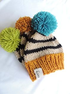 "Choose from three hats.  Green pompom, Gold Pompom or Blue pompom.  It is perfect for fall and winter. This beanie is made to order.Handmade with soft, plush durable acrylic yarn.Sizing Chart - All measurements are approximate.6-12 Months 16""-18""1-3 yrs.   18""-20""3-5 yrs.    19""-21""5-10 yrs.  20""-21""12 yrs - adult 21"" - 23""Care: Hand wash lay flat to dry.Pieces are safely secured.Some beanies have small buttons and braids that can pose a choking hazard.Please do not leave children… Loom Knit Hat, Crochet Beanie Pattern, Loom Knitting, Knit Hats, Crochet Hats, Fair Isle Knitting Patterns, Beginner Crochet Projects, Baby Boy Hats, Baby Hats Knitting"