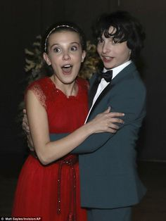 Hugs: There was no shortage of hugs going around backstage as the Stranger Things cast celebrated their huge victory, as Finn Wolfhard and Millie were also spotted embracing each other