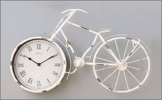 Decorative rustic look Bicycle Clock - £18 Features a clock in the front wheel with Roman numeral hour markers, hour and minute hands.  The whole bike is finished in a rustic look. Ideal for any room in the house.  Size H35 x W57 x D5.5cm  Message me as usual to order yours – Megan