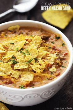 slow_cooker_beefy_nacho_soup_All of the goodness of cheesy nachos packed right into this soup!  Slow cooked to perfection and topped with tortilla chips, this soup will become an instant favorite!