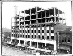 Bondi Building under construction. Date Original	 ca. 1929 Description	 Photograph shows the seven-story Bondi Building under construction. Five men are on the two highest floors. A sixth man, barely visible, is laying on the top floor reaching down to something on the side of the building. Kline's Department Store sign and building can be seen on the lower left.  311 to 313 East Main Street, Galesburg, Knox County, Illinois