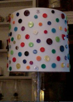 buttons on a lamp.  all colors, lay out pattern on white paper first.  hot glue on to shade.