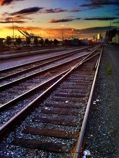 Tracks heading north toward the City of Seattle at sunset. Copyright © 2012 Patrick Robinson.