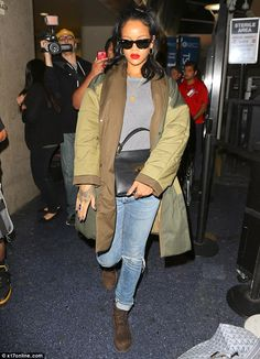 cb58d9cdab Rihanna covers up in yet another coat... but wears see-through top