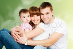Image of 'happy family with a baby on a color background'