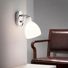 the spirit frosted glass and chrome wall light or reading light by nordlux is a functional bedside lighting wall mounted