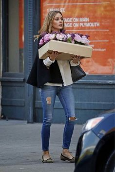 naimabarcelona:  Olivia Palermo wears ripped jeans while carrying a box of flowers in Brooklyn, New York