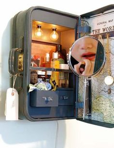 Suitcase used as a medicine cabinet.  Don't know if I'd every use it, but I love the idea!   Maybe alter a bit?