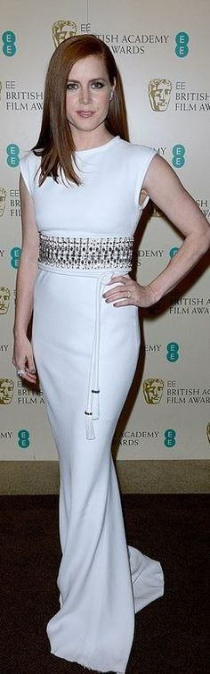Amy Adams: Dress and purse – Lanvin  Shoes – Jimmy Choo  Jewelry – Cartier