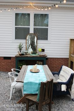 Outdoor Entertaining Ideas fab diy runner and awesome lights!  love the mirror outside.