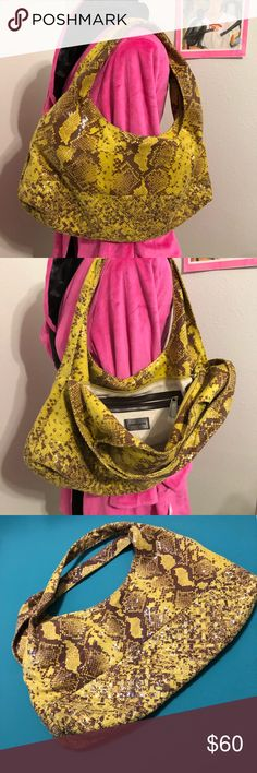 "NWOT Antonio Melani Snake Skin print Hobo Bag 👜 NWOT  👜 Antonio Melani  👜 Snake Print Leather Hobo Bag 👜 woven on bottom  👜 Approx 19""w x 10""L (bag only) 👜 Zippered top, zippered inside pocket, plus two additional side pockets   Get yourself ready for Fall! ANTONIO MELANI Bags Hobos"