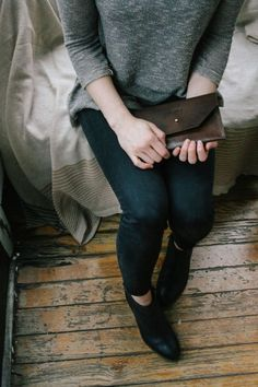 flat ankle boots+ brown clutches