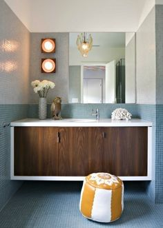 Vanity with white frame and wood doors, plus small tile everywhere.  Love it.