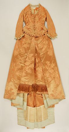 Dinner dress  House of Worth (French, 1858–1956)  Designer: Charles Frederick Worth (French (born England), Bourne 1825–1895 Paris) Date: ca. 1877 Culture: French Medium: silk Dimensions: [no dimensions available] Credit Line: Gift of Estate of Mrs. Pierpont Morgan, 1925