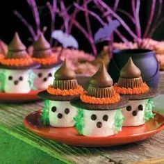 Marshmallow Witches  Ingredients 1/2 cup vanilla frosting, divided 36 miniature semisweet chocolate chips 12 large marshmallows 1 drop each green, red and yellow food coloring, optional 1/4 cup flaked coconut 12 chocolate wafers 12 miniature peanut butter cups 12 milk chocolate kisses  Directions For the face of each witch, place a dab of frosting on the bottom of three chocolate chips; press two for eyes and one for nose onto each marshmallow. For hair, combine green food coloring and a…