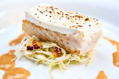 Perch pike gratinated with goat cheese, served on a bed of leek and walnuts, with lobster veloutée